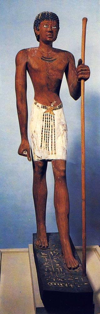 Fig 3. Escultura en madera de Niankhpepi, -el negro-. Dinastía VI. Museo de El Cairo. Foto en J. P. COR-TEGGIANI, L' Egypte des pharaons au Musée du Caire, París, 1986, p. 60.