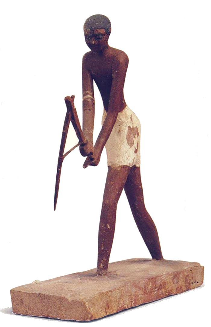 Fig. 7. Hombre arando. Foto en Tesoros egipcios de la colección del Museo Egipcio de El Cairo (obra coordinada por F. TIRADRITTI), Barcelona, 2000, p. 100.
