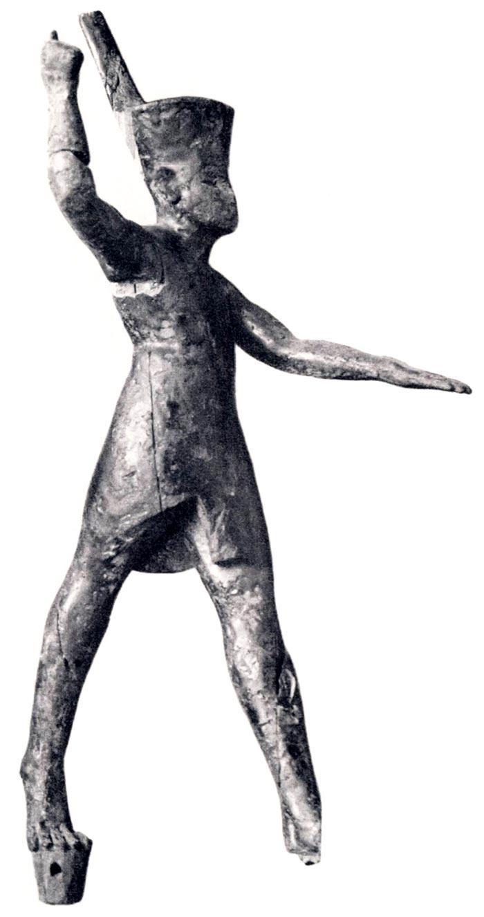 Fig. 11. Figurilla en madera localizada en la tumba de Amenofis II. Foto en catálogo de la exposición: Toutankhamon. L'or de l'Au-Delà. Trésors funéraires de la Vallée des Rois, París, 2004, p. 100. Fig. 39